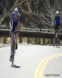 Two Bicyclists Road Racing